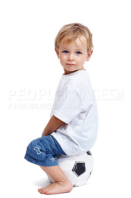 Buy stock photo Portrait of a happy small adorable kid sitting on the soccer ball isolated over white background