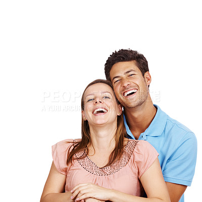 Buy stock photo Cheerful young man hugging his girlfriend from behind and smiling against white background