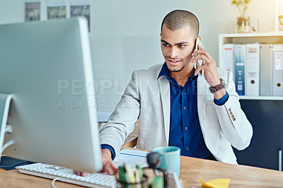 Buy stock photo Cropped shot of a young businessman talking on a cellphone in an office