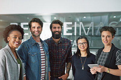 Buy stock photo Cropped portrait of a group of creative businesspeople standing in their office