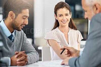 Buy stock photo Cropped portrait of a businesswoman sitting in a meeting with two of her colleagues
