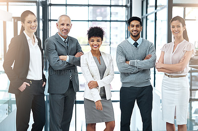 Buy stock photo Portrait of a happy group of colleagues standing together in a modern office