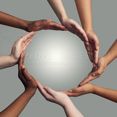 Buy stock photo Cropped shot of a group of hands linking together to form a circle against a grey background