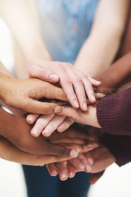 Buy stock photo Cropped shot of a group people  putting their hands together in unity
