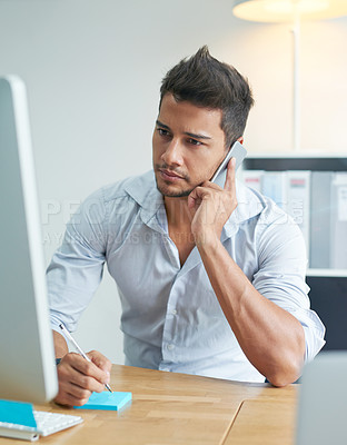 Buy stock photo Shot of a worried businessman talking on his phone while looking at his computer