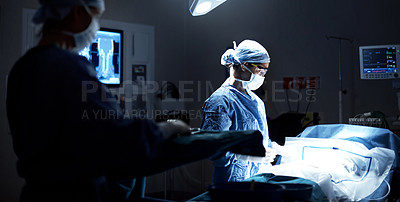 Buy stock photo Shot of a surgeon preparing for surgery