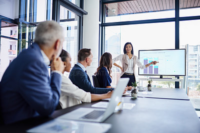 Buy stock photo Cropped shot of a businesswoman giving a presentation in a boardroom
