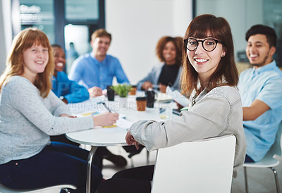 Buy stock photo Cropped portrait of a group of young businesspeople sitting in a boardroom during a meeting