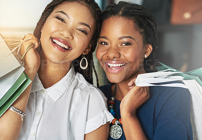 Buy stock photo Cropped shot of two women smiling and holding shopping bags