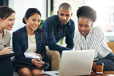 Buy stock photo Shot of a group of businesspeople talking together over a laptop during a meeting