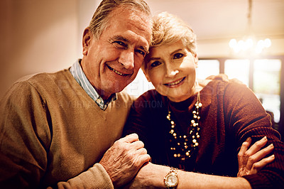 Buy stock photo Cropped portrait of an elderly couple embracing in their home
