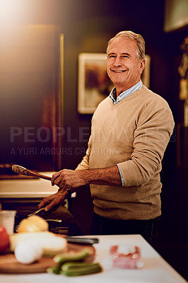 Buy stock photo Portrait of an elderly man cooking a meal in his kitchen