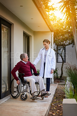Buy stock photo Shot of an elderly man in a wheelchair being assisted by a nurse outside a clinic