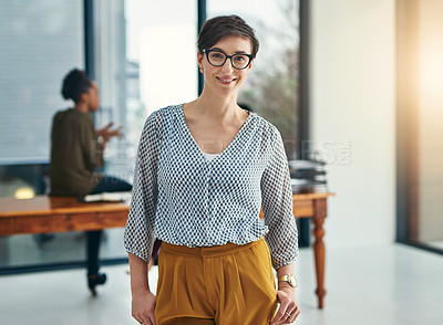 Buy stock photo Portrait of a young creative standing in an office with colleagues in the background