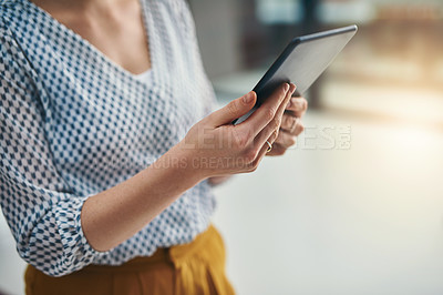 Buy stock photo Closeup shot of a businesswoman working on a digital tablet in an office