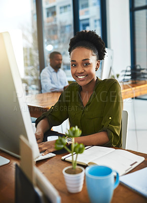 Buy stock photo Cropped portrait of a businesswoman working on her computer in the office