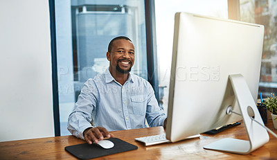 Buy stock photo Cropped portrait of a businessman working on his computer in the office