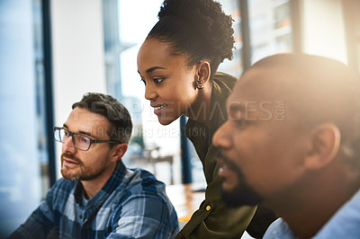 Buy stock photo Cropped shot of three businesspeople working together in the office