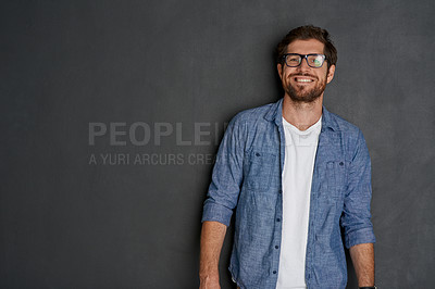 Buy stock photo Studio portrait of a young man standing against a grey background
