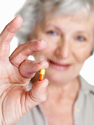 Buy stock photo Closeup portrait of a blur sick mature woman showing a tablet
