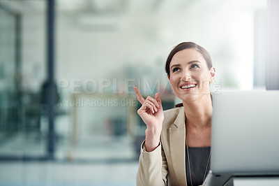 Buy stock photo Shot of a professional businesswoman looking inspired by a thought at work