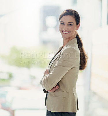 Buy stock photo Portrait of a happy and confident businesswoman working in a modern office