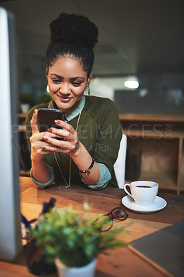 Buy stock photo Shot of an attractive young woman using her cellphone in the office