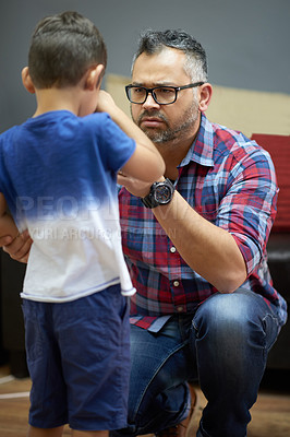 Buy stock photo Shot of a concerned father consoling his little boy at hoome
