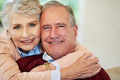 Buy stock photo Shot of a senior woman embracing her husband from behind