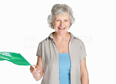 Buy stock photo Portrait of a happy senior female holding a Saudi Arabian flag against white