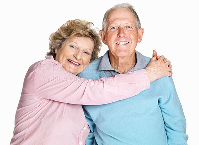 Buy stock photo Portrait of a happy senior couple embracing each other against white