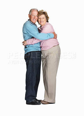 Buy stock photo Full length of a happy senior couple hugging each other against white