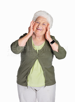 Buy stock photo Portrait of a happy mature woman with hands on chin against white background