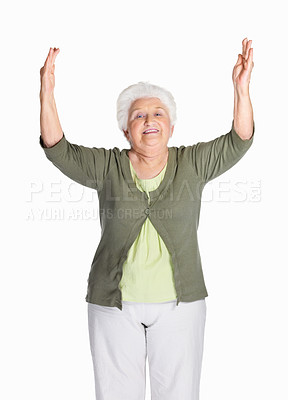 Buy stock photo Portrait of a happy mature woman with hands raised isolated against white