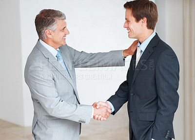 Buy stock photo Portrait of a mature businessman shaking hand with his colleagues at office
