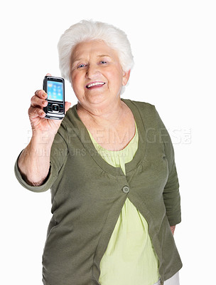 Buy stock photo Portrait of a happy mature woman displaying her mobile isolated on white