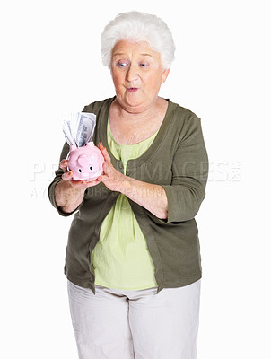 Buy stock photo Portrait of a surprise mature woman holding piggy bank isolated on white