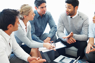 Buy stock photo Business man viewing his ideas to his colleagues during meeting