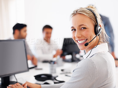 Buy stock photo Beautiful female customer service executive working on computer and smiling at you