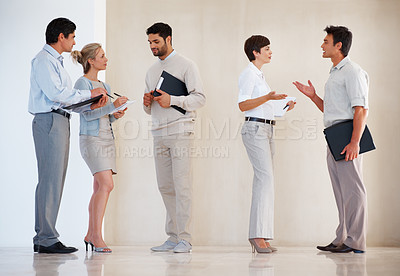 Buy stock photo Group of business people having conversation with each other