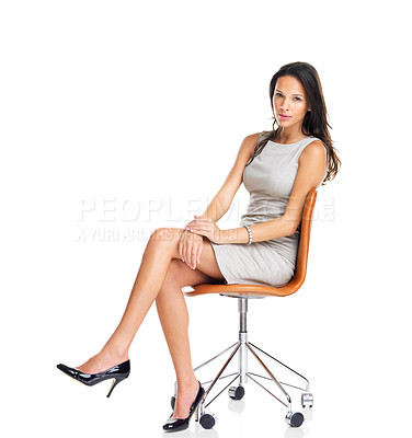 Buy stock photo Portrait of a brunette businesswoman sitting in a chair isolated on white background