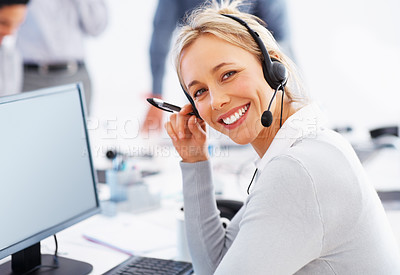 Buy stock photo Happy female customer care representative looking at you and smiling