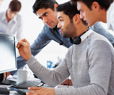 Buy stock photo Business people discussing project on computer with colleague in background