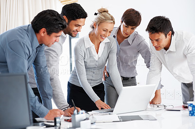 Buy stock photo Group of successful business people working on laptop during meeting