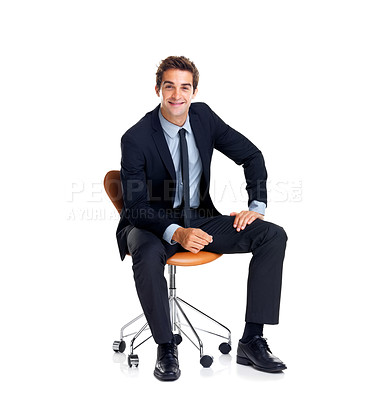 Buy stock photo Successful young male business executive sitting on a chair against white background
