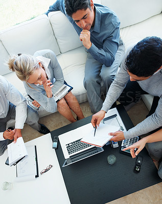 Buy stock photo High angle view of male leader discussing project with his colleagues in meeting