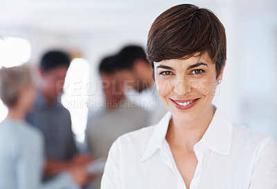 Buy stock photo Closeup of beautiful business woman with colleagues discussing in background