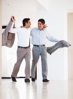 Buy stock photo Full length of friendly business colleagues walking with arms around