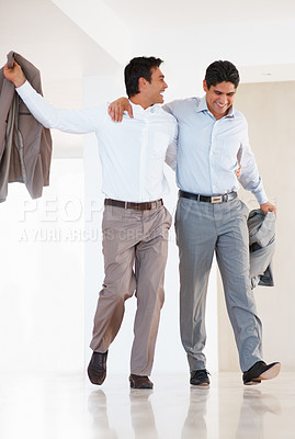 Buy stock photo Full length of smiling business colleagues walking with arms around