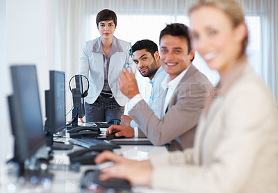 Buy stock photo Portrait of business people working together and looking at you